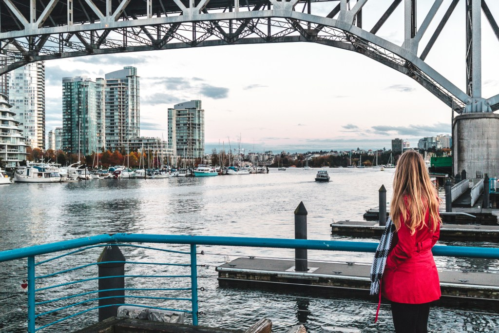 woman gazing out at the False Creek waterway