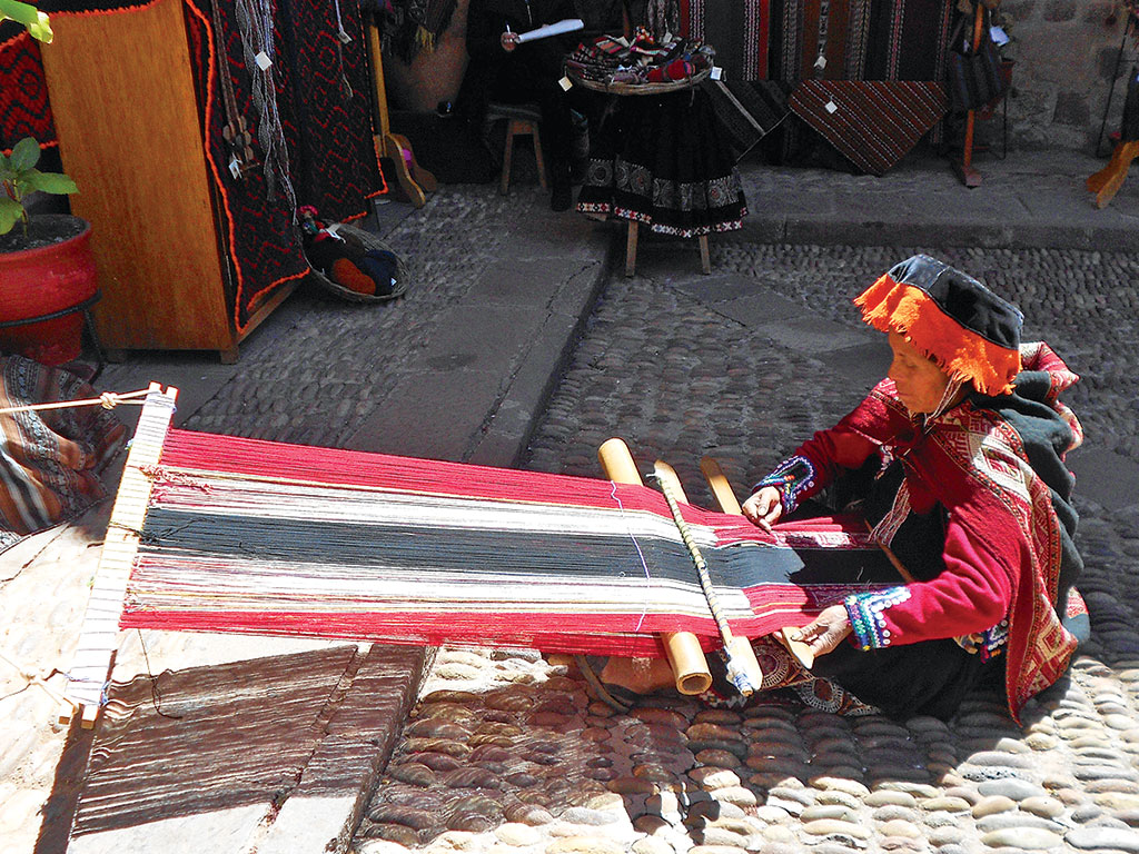 indigenous woman weaving