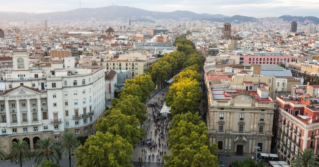 aerial view of a tree-lined street surrounded by a cityscape in Barcelona