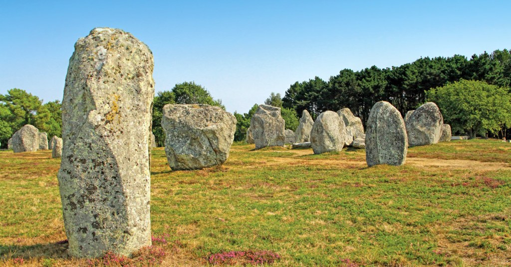 oversized stones standing in a field in Brittany
