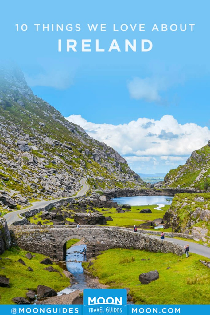 Stream and road going through a gap in rocky, grassy hills. Gap of Dunloe, Ireland. Pinterest graphic.
