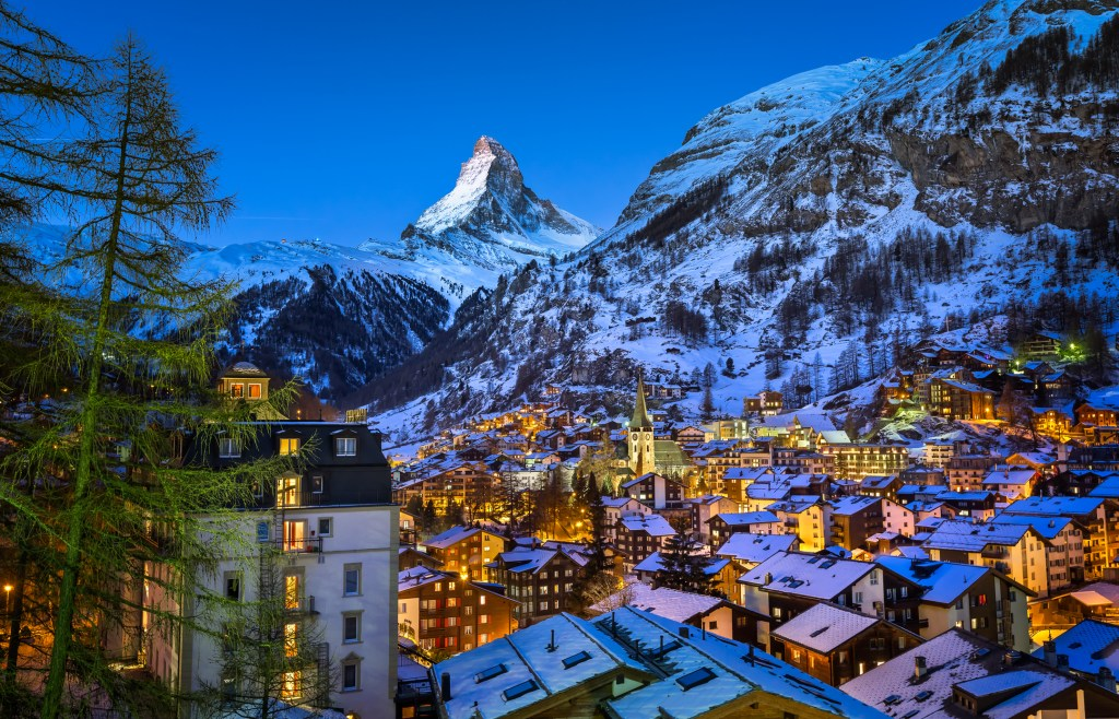 mountain town sitting under the snowy peaks of Matterhorn