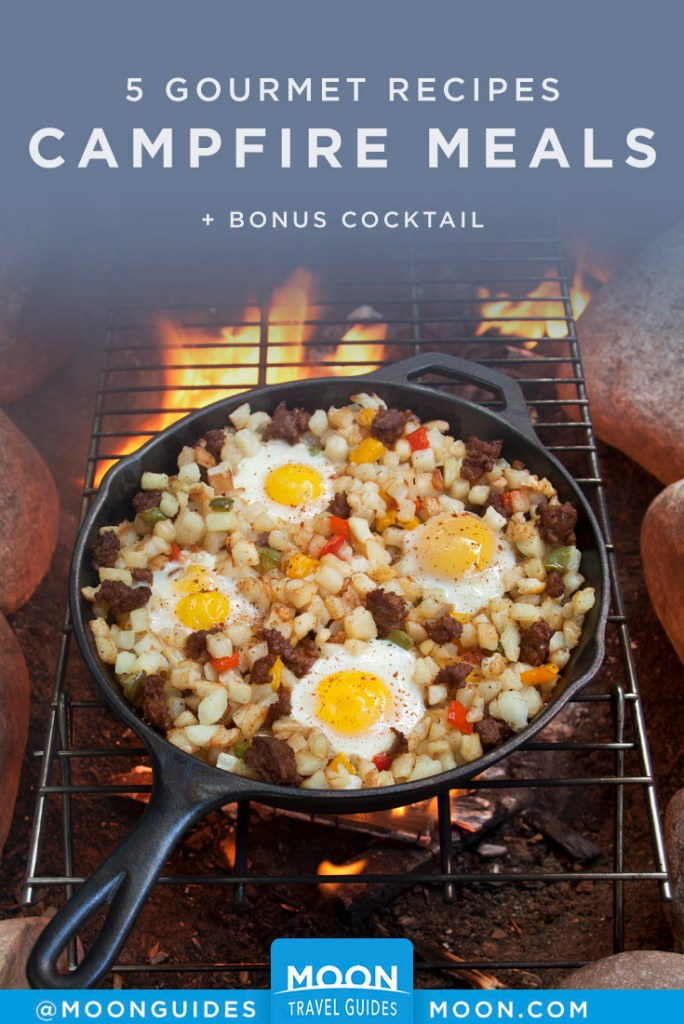 Breakfast hash in a skillet over a campfire. Pinterest Graphic.