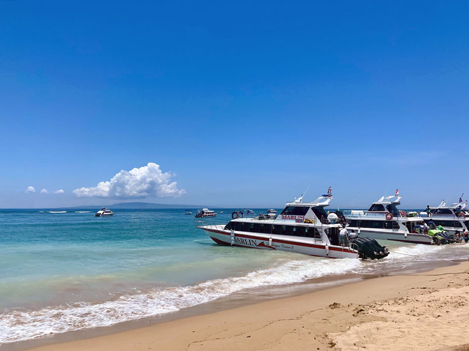 speed boats docked on a shoreline of a beach