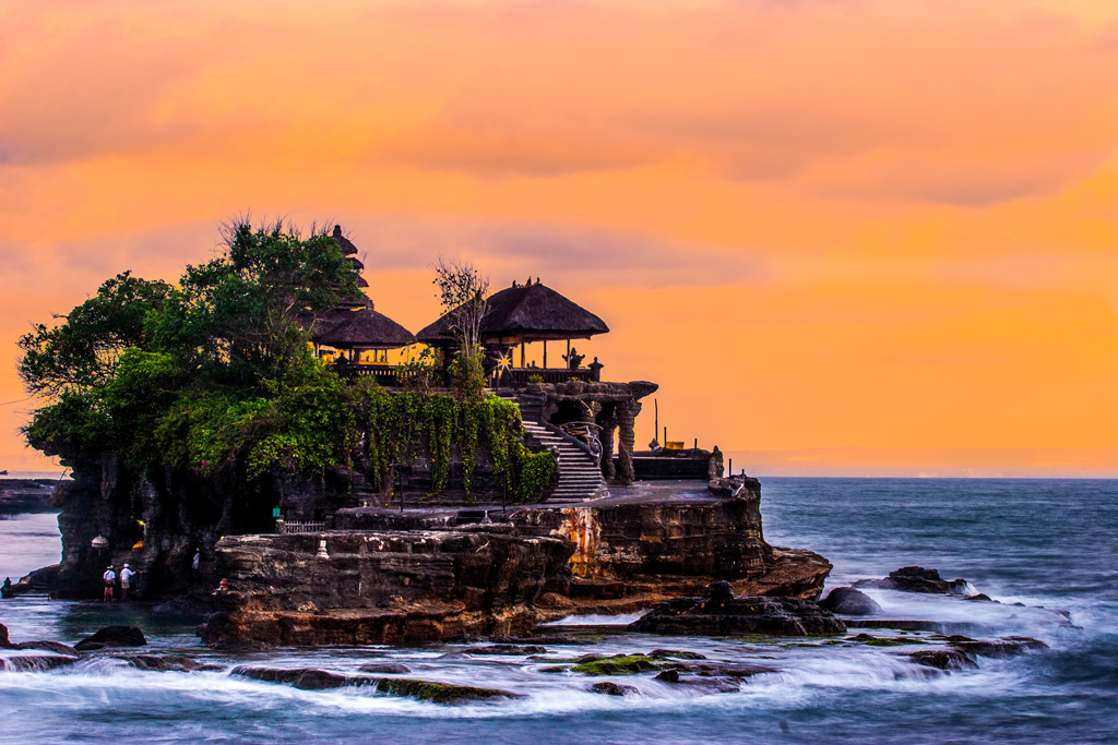 image of Pura Tanah Lot at sunset with orange skies