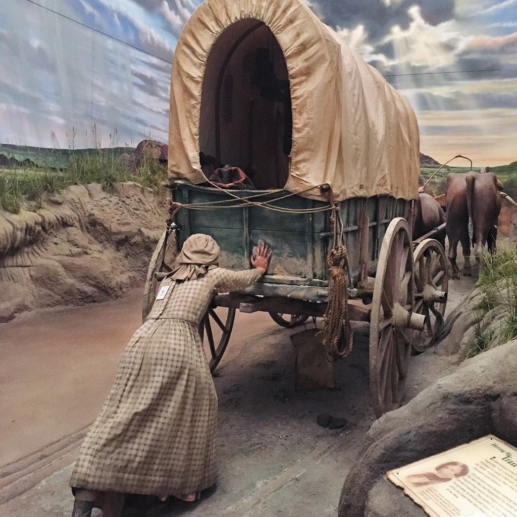 exhibit at the archway museum of women pushing cart
