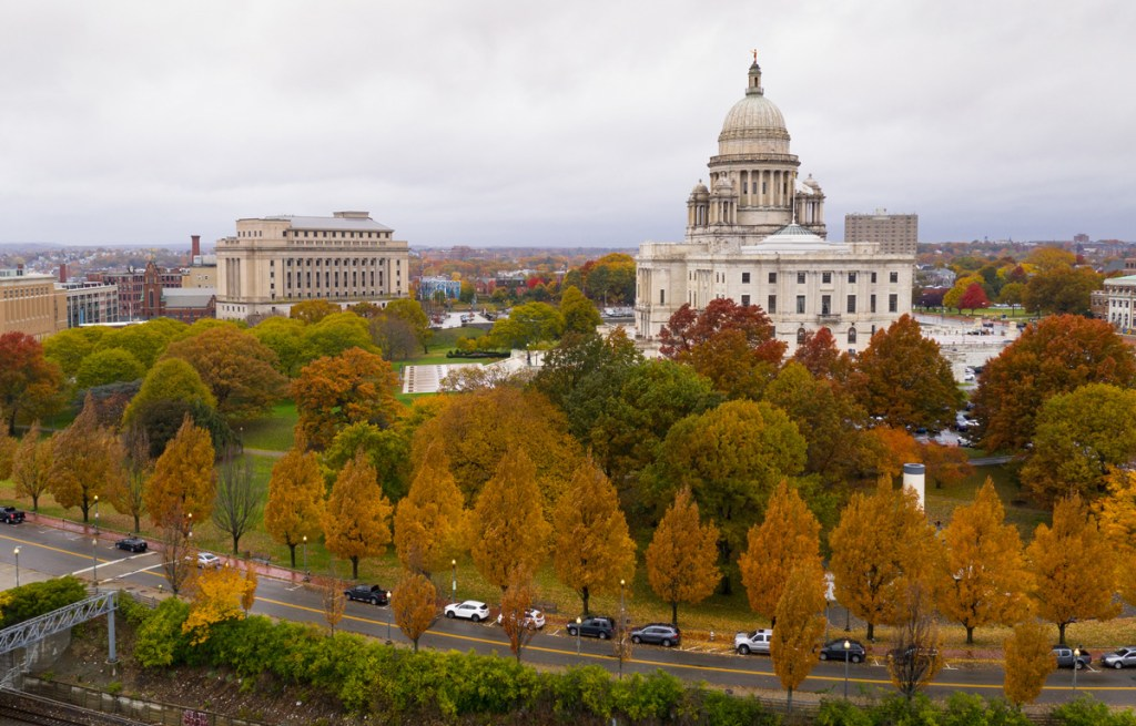 trees in amber hues surrounding the capitol building in providence