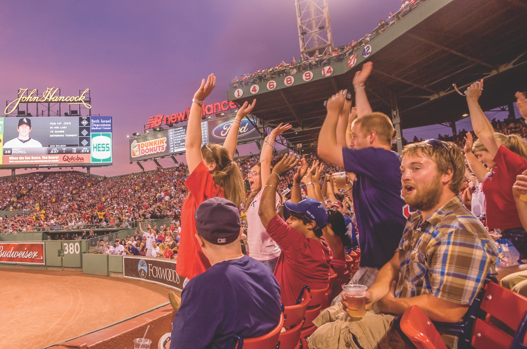 Photo of fans cheering at Fenway Park