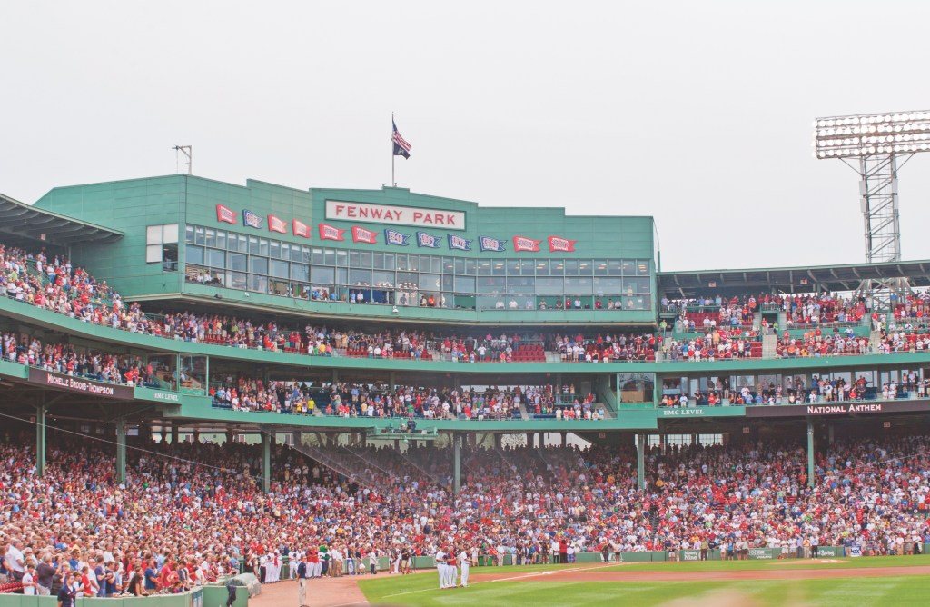 Crowded seats on a cloudy day Fenway Park
