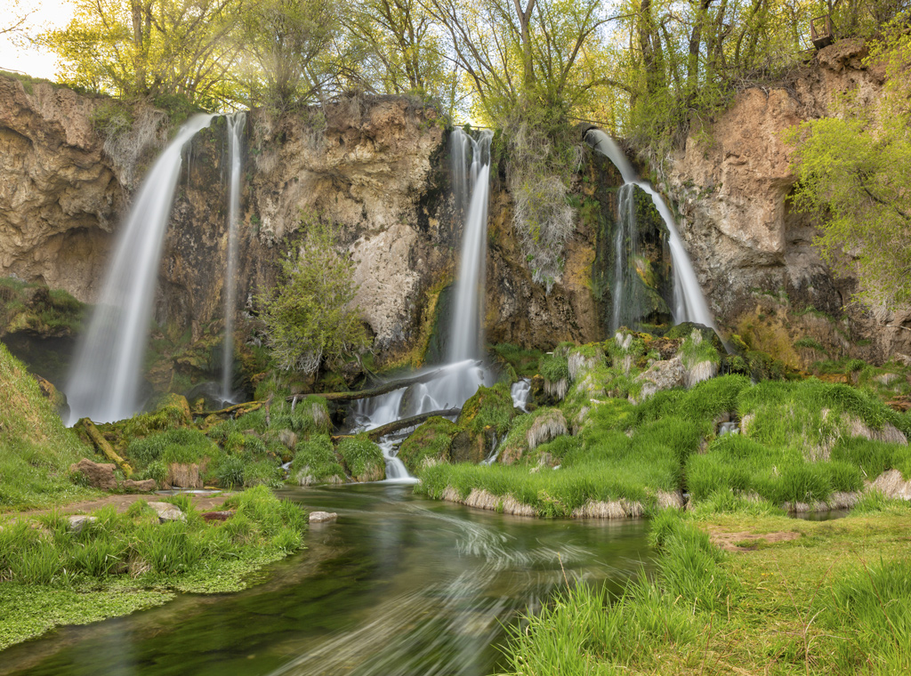 A long exposure of a triple falls at Rifle Falls in the lush Springtime, in Rifle Falls State Park, Colorado.