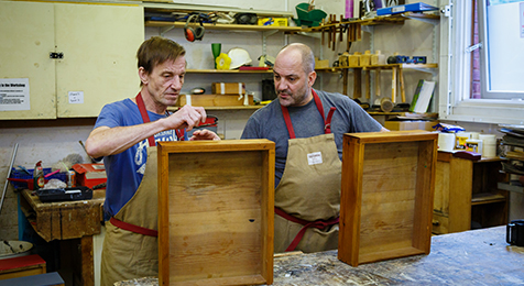 Two volunteers at Restoration Station in Shoreditch. Photograph: Spitalfields Crypt Trust