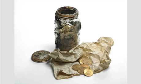 Gold coins and glass jar
