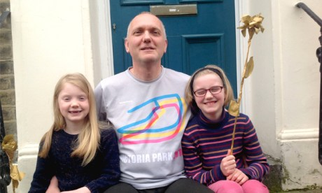 Marathon man: Adrian Peacock with his two daughters