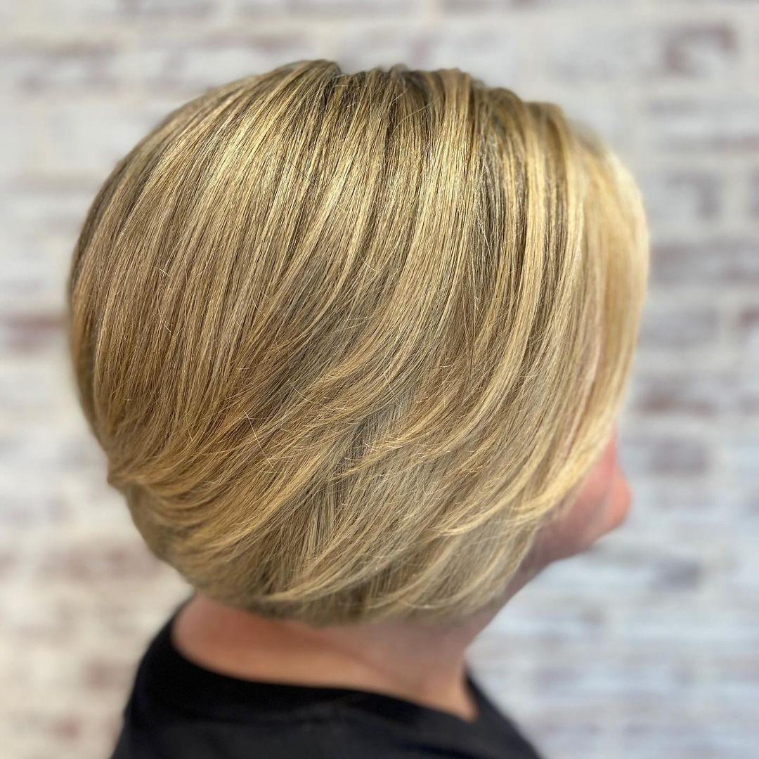 Short Feminine Hairstyle with Swoopy Layers