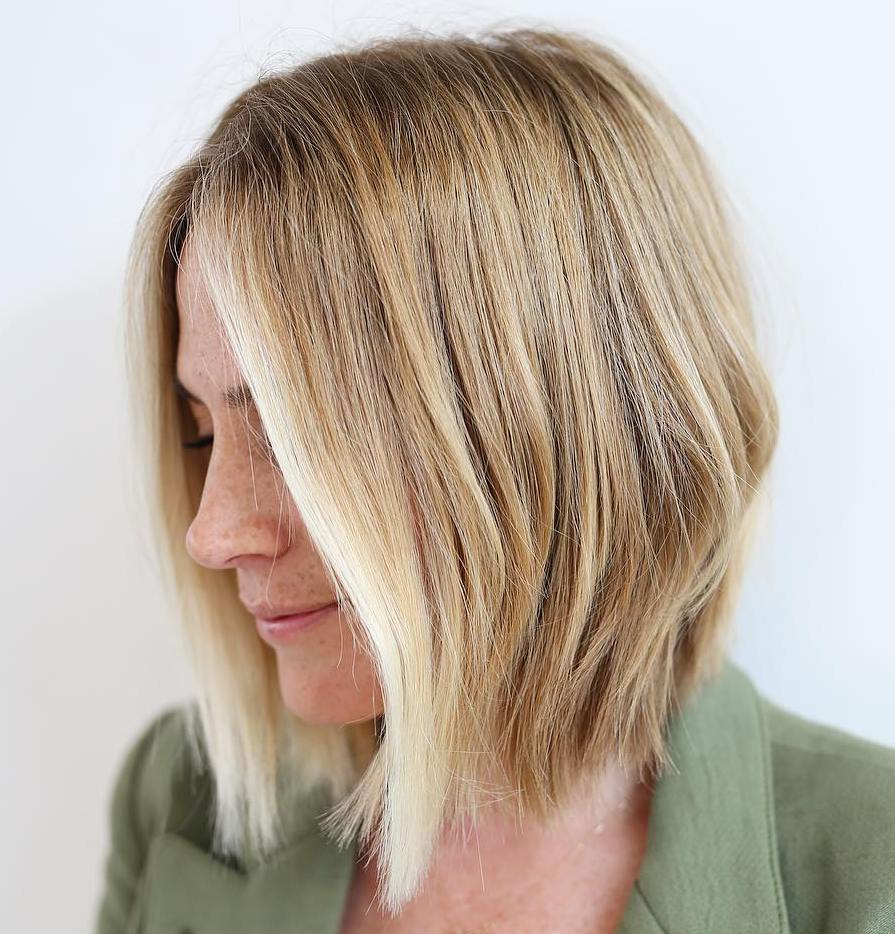 Thin Medium Blonde Bob with Face-Framing Highlights