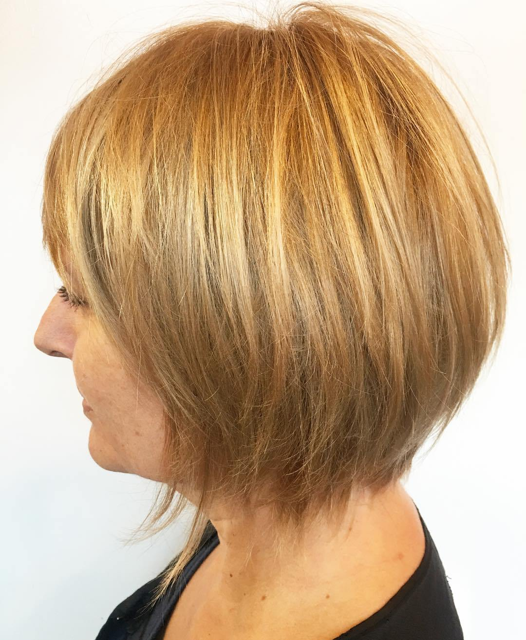 Golden Blonde Layered Bob with Bangs and Thinned Ends