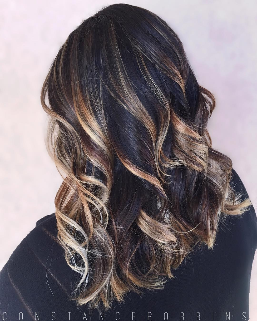 Black Hair with Blonde and Caramel Highlights