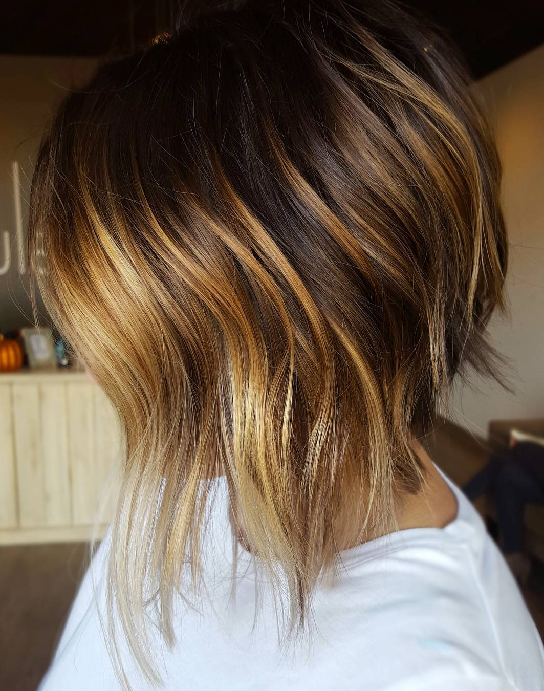 Inverted Brown Bob with Golden Face Framing Highlights