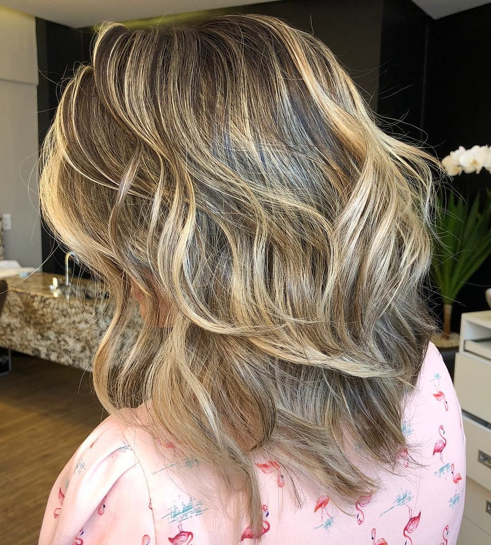 Medium Layered Cut with Blonde Balayage