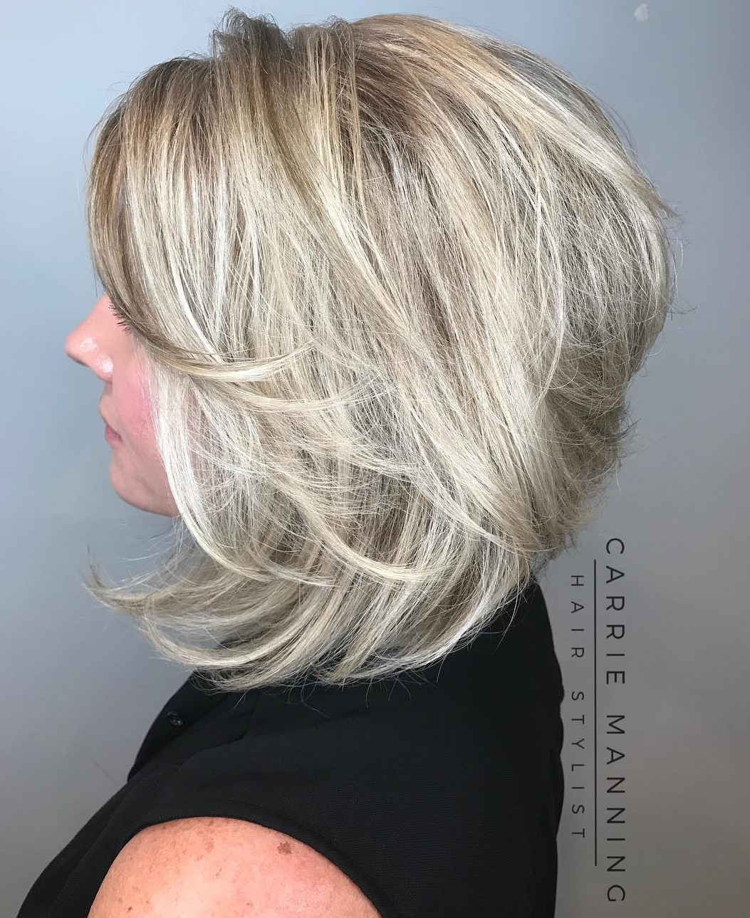 Mid-Length Layered Inverted Blonde Bob