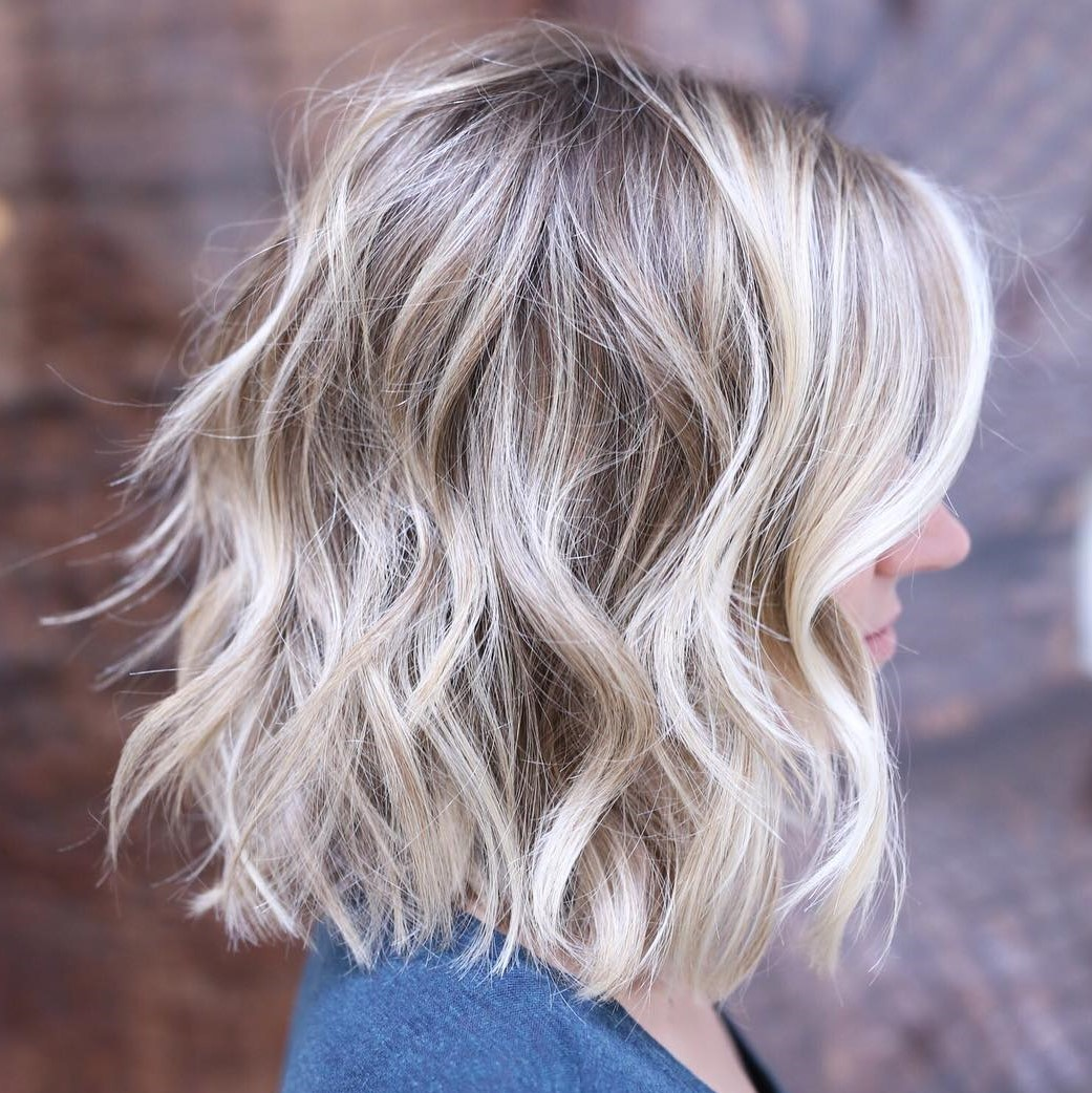 One-Length Shaggy Wavy Blonde Bob with Highlights