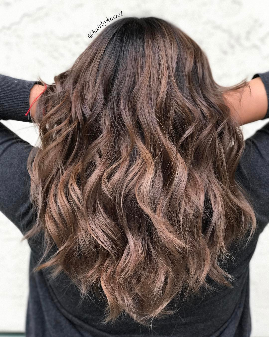 Mid-Back Wavy Layered Hairstyle