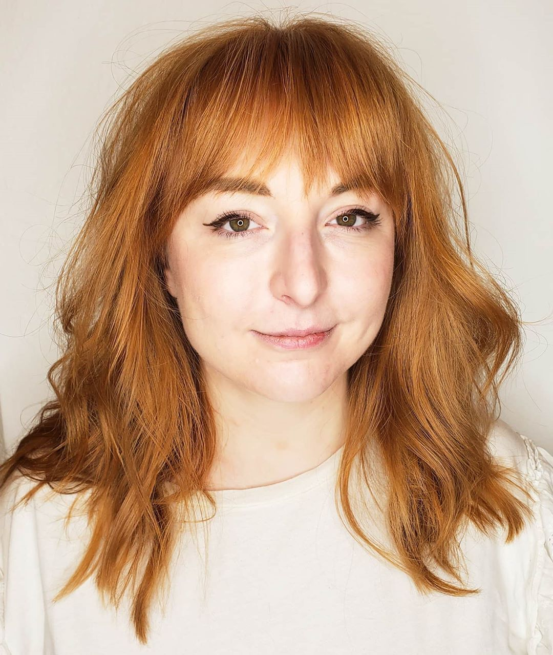 Mid Length Thick Hairstyle with Bangs