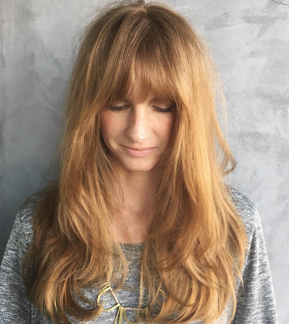 Strawberry Blonde Hair with Layers and Bangs