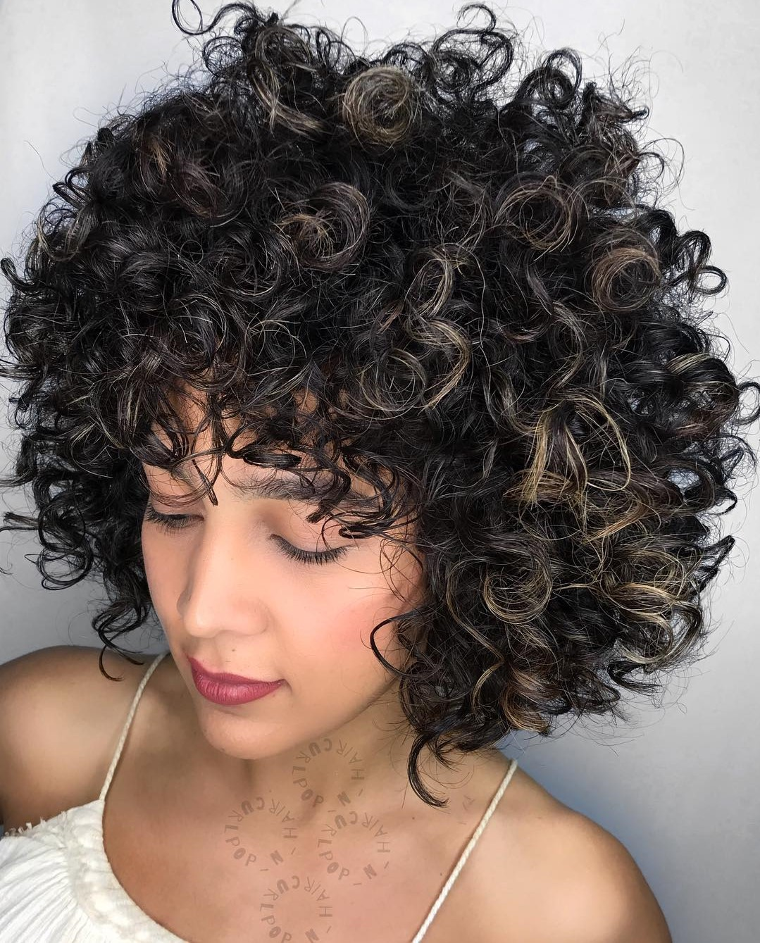 Dark Curly Hairstyle with Bangs