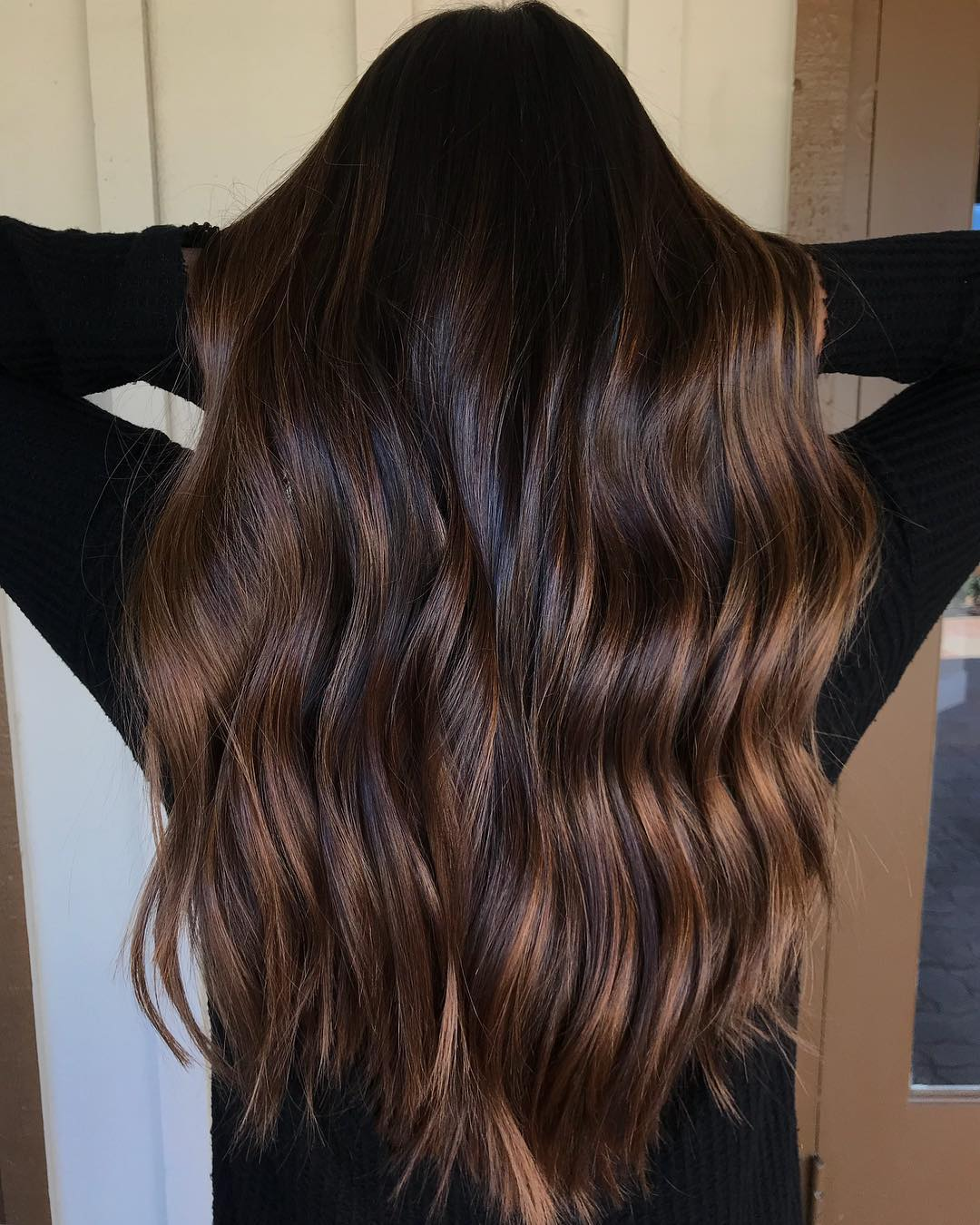 Dark Wavy Locks with Light Brown Highlights