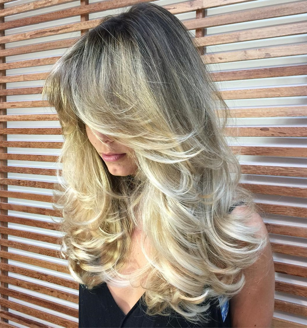 Long Gray Blonde Hairstyle with Dark Roots