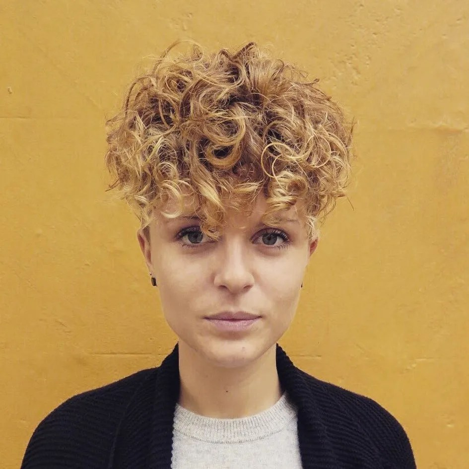 Wavy Haircut with Long Top Short Sides