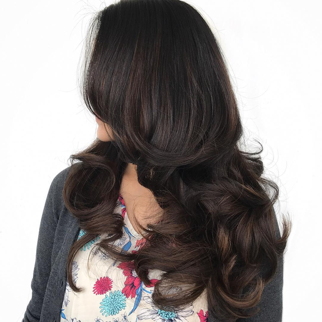 Layered Haircut with Large Curls