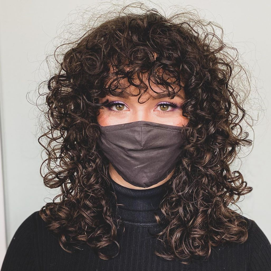 Long Haircut with Bangs for Curly Hair
