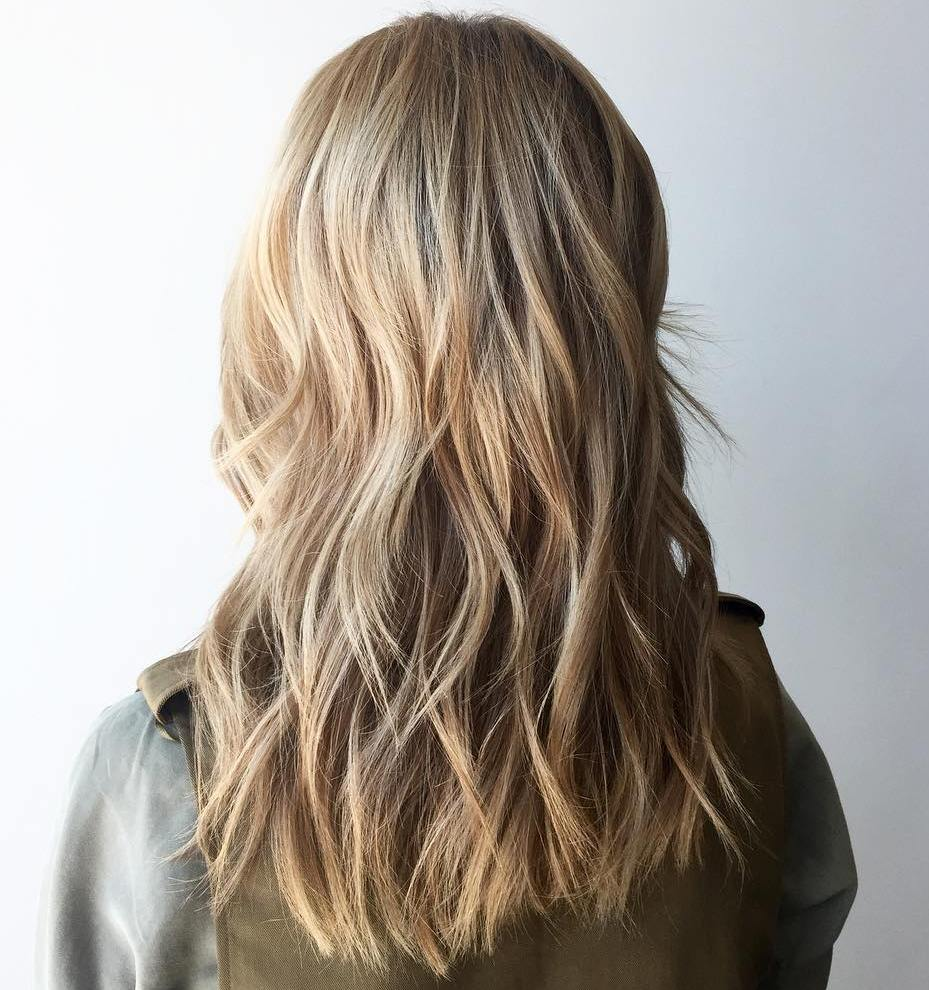Modern Long Blonde Shaggy Haircut