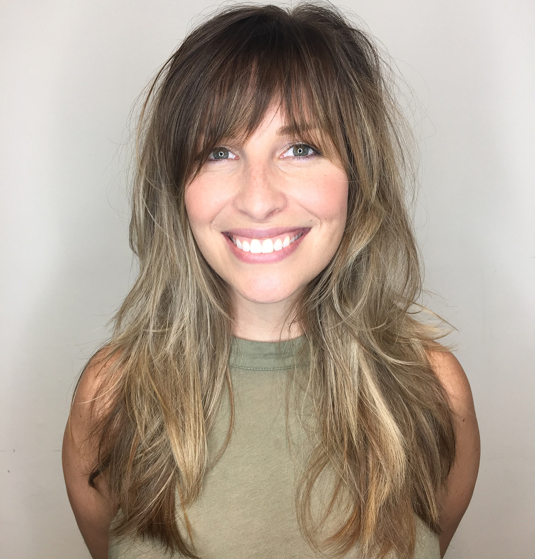 Long Haircut with Shaggy Layers and Bangs