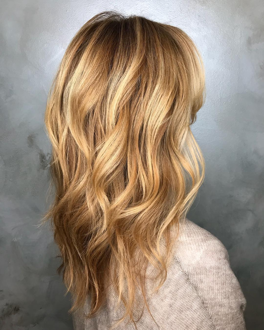 Layered Haircut with Waves and Highlights