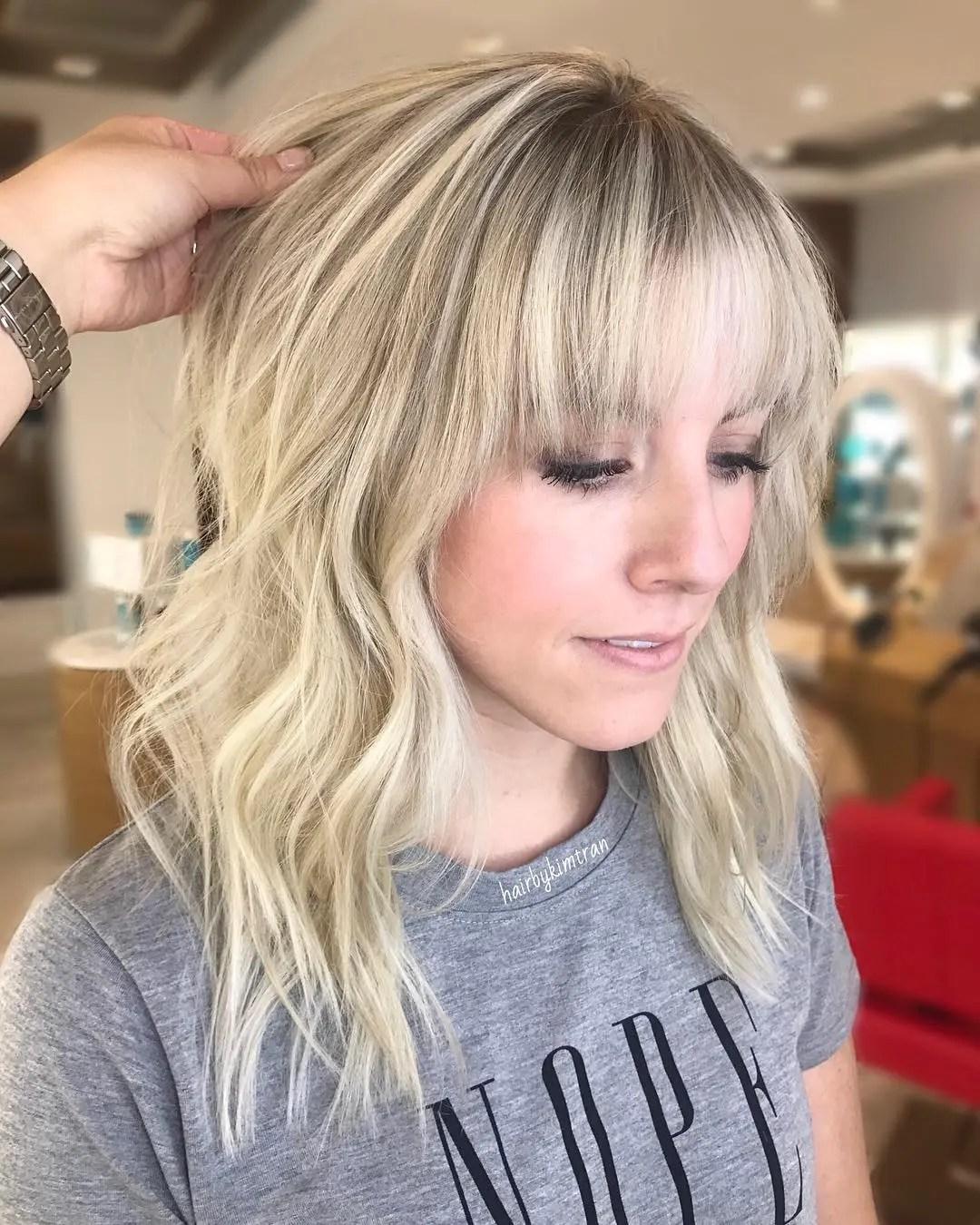 Layered Wavy Hair with Choppy Bangs