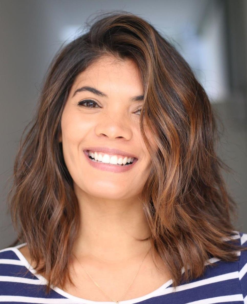 Medium Female Haircut for Wavy Hair