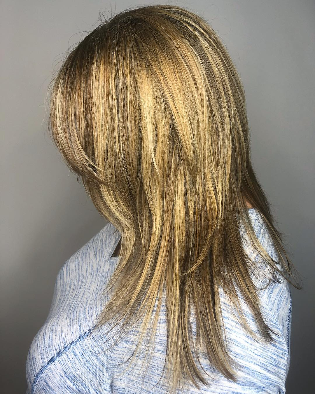 Long Shaggy Metallic Blonde Haircut