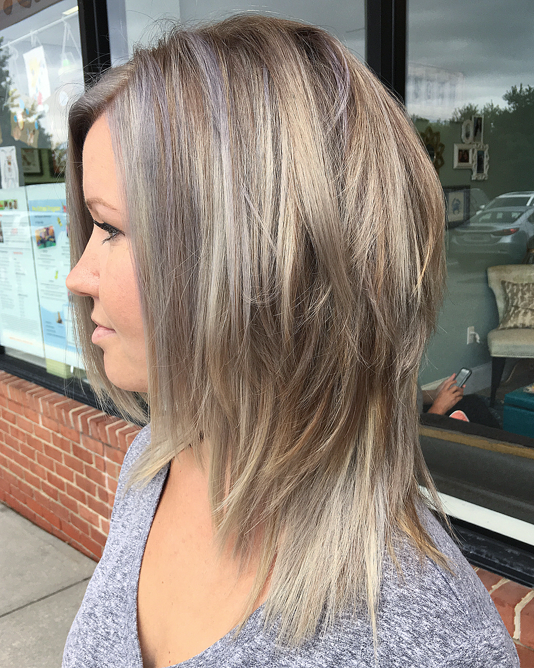 Blonde Layered Hairstyle with Gray Highlights