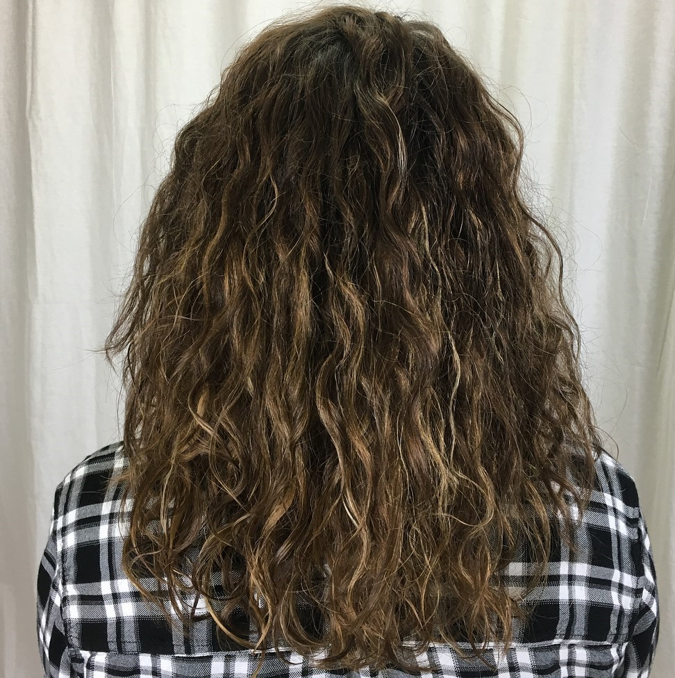 Perm Curls with Sun-Kissed Highlights