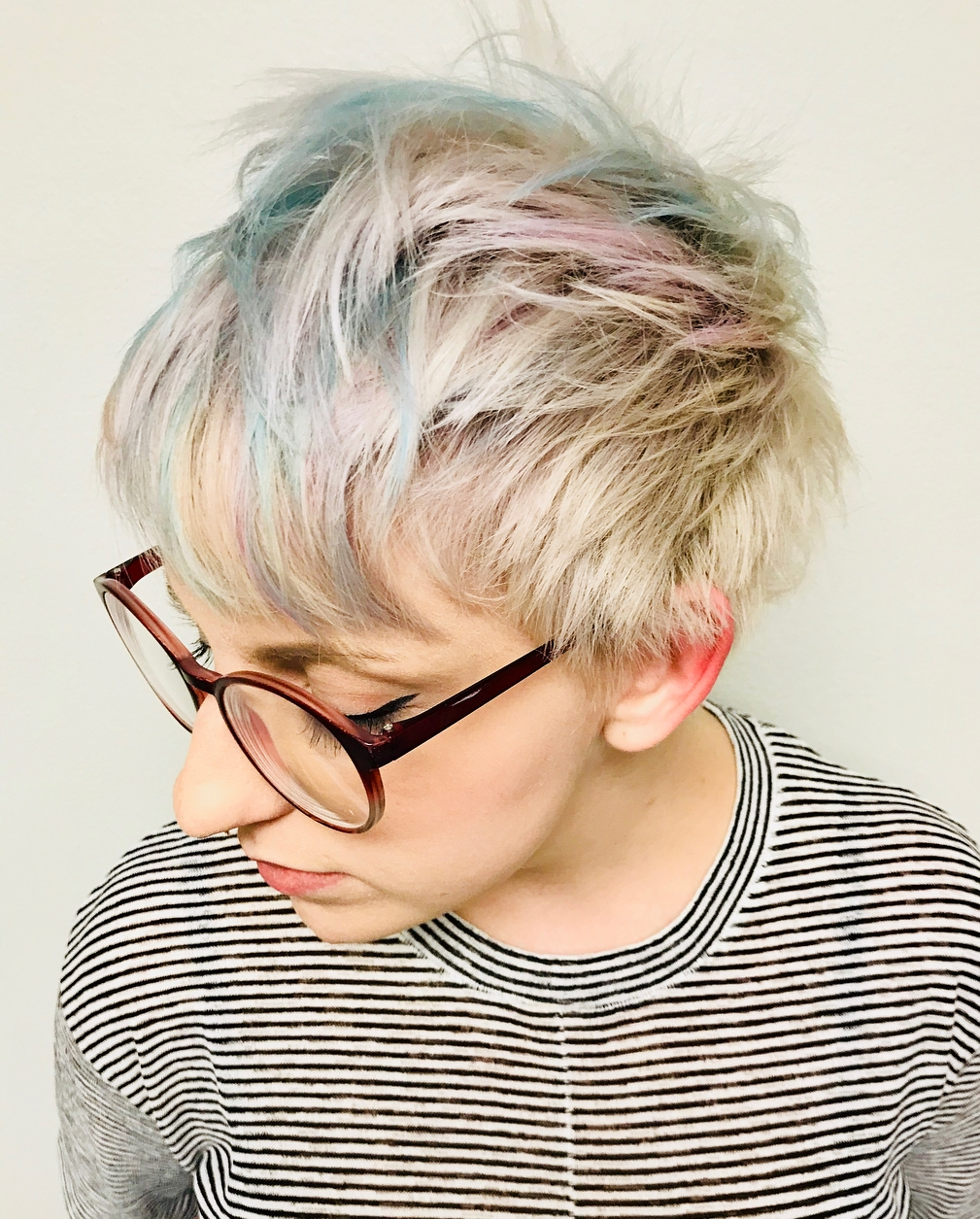 Shaggy Blonde Pixie with Pink and Blue Highlights