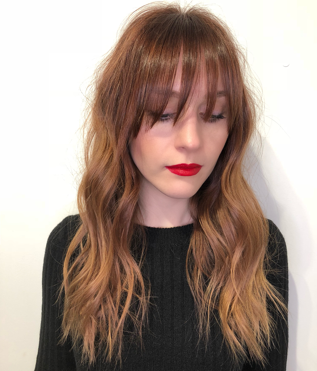 Wavy Red Hairstyle with Long Bangs