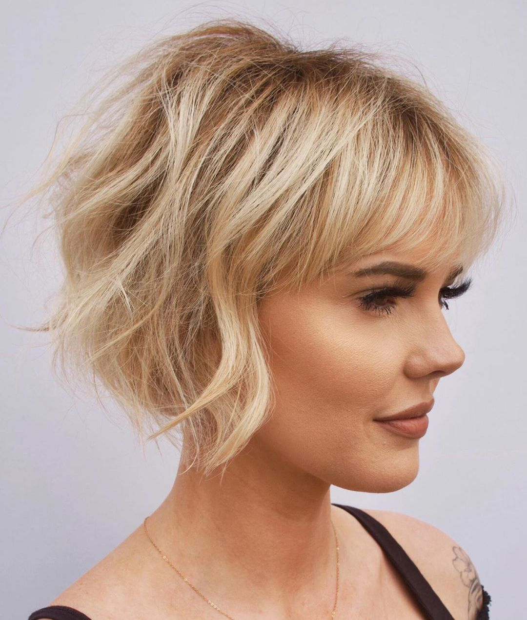 Short Women`s Haircut with Bangs