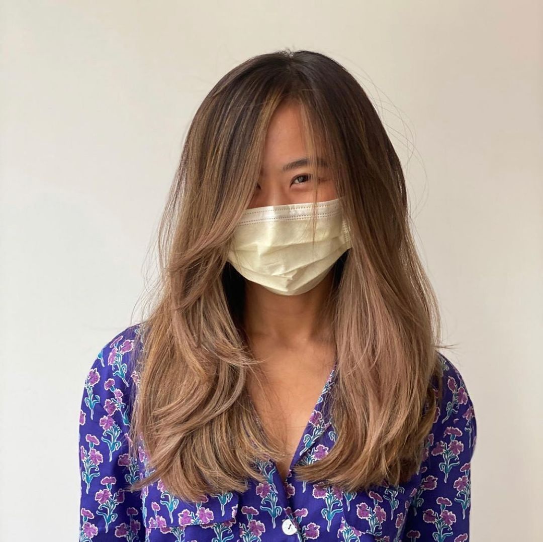 Easy-to-Maintain Hair with Layers and Bangs