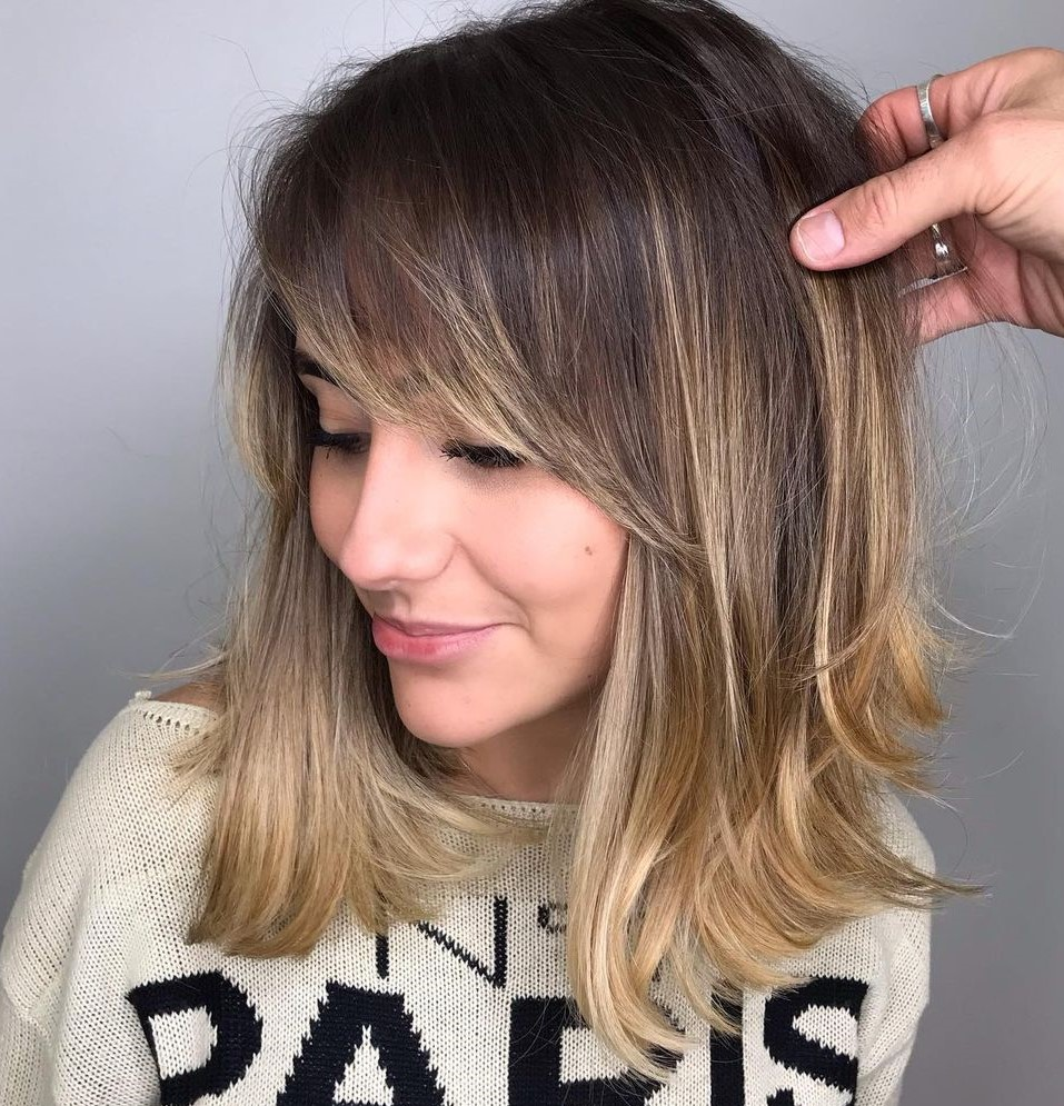 Medium Hairstyle with Bangs for Women