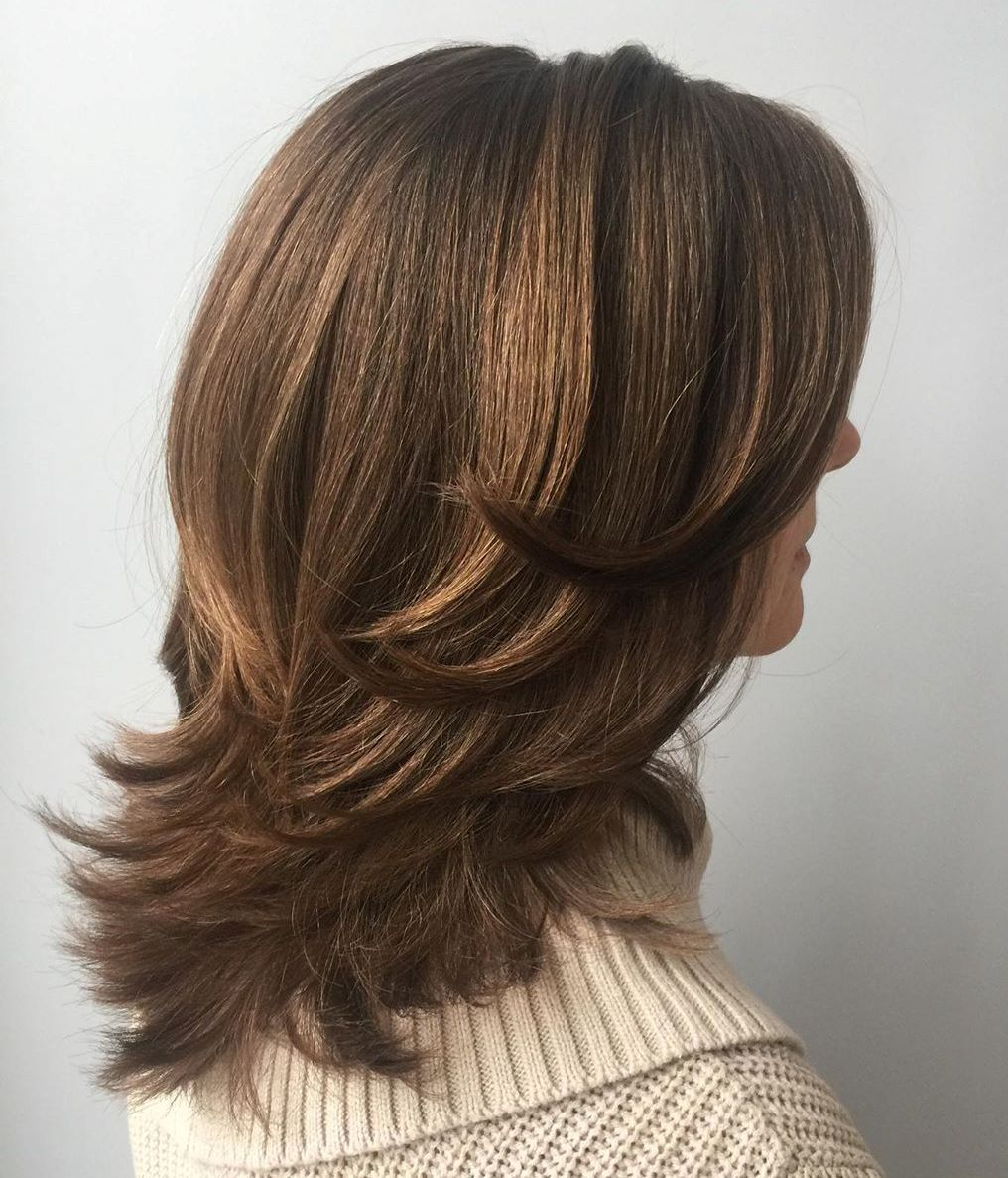 Mid-Length Hair with Flipped-Up Feathered Layers