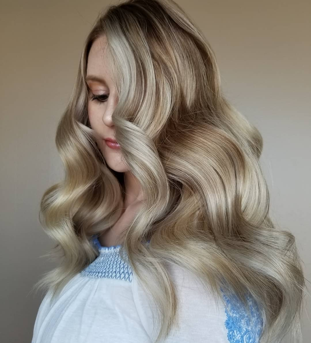 Glossy Sandy Blonde Balayage Hair
