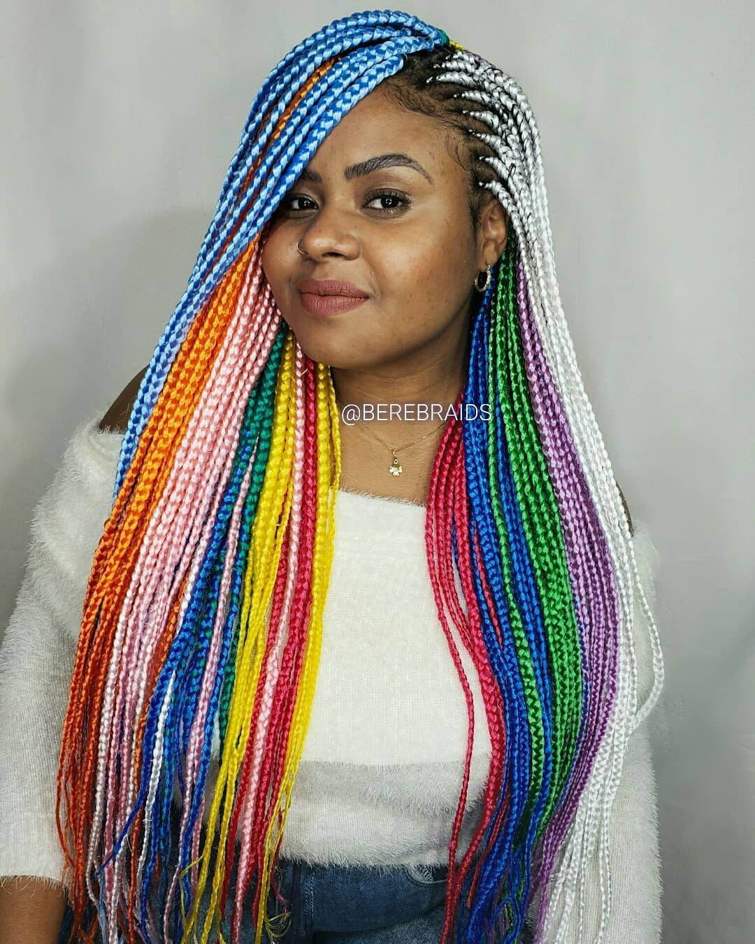 Bright Colorful Box Braids with a Side Part